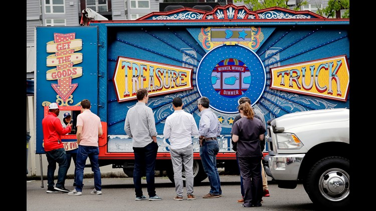 Customers line-up to pick-up their deal of the day purchase at an Amazon Treasure Truck at a parking lot in Seattle. The Treasure Truck is a quirky way for the online retailer to connect with shoppers in person, expand its physical presence and promote it