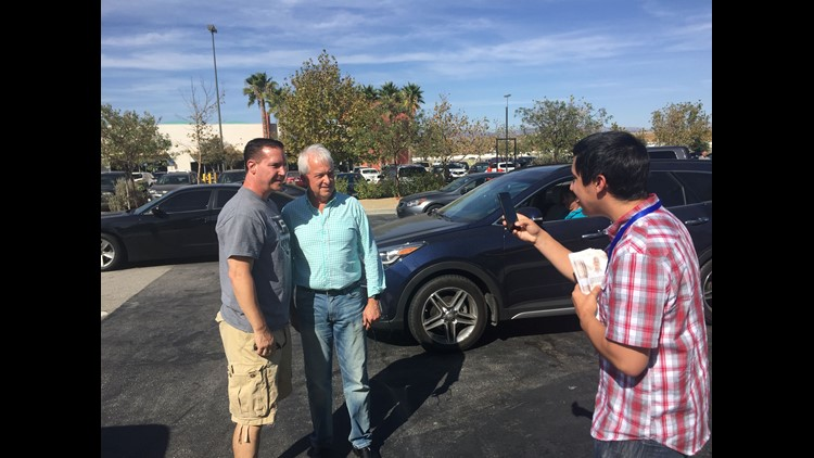 John Cox, center, poses for a photo. He is the Republican candidate for governor of California