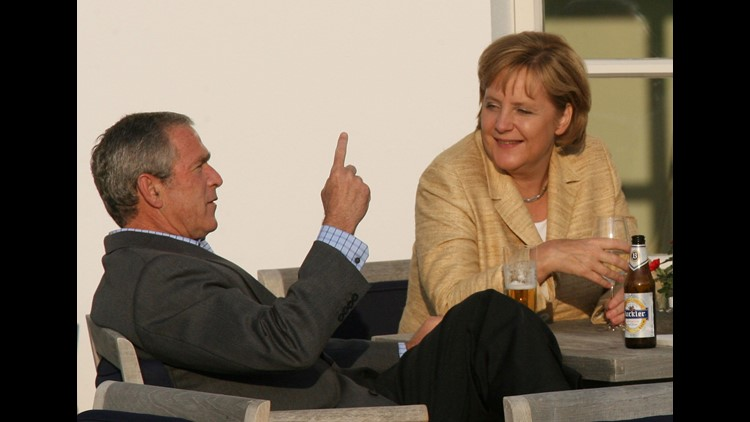 President George W. Bush and German Chancellor Angela Merkel have an aperitif with other G8 leaders on the terrace of the Kempinski Grand Hotel in Heiligendamm, northeastern Germany, following a working session of the G8 Summit on June 7, 2007.