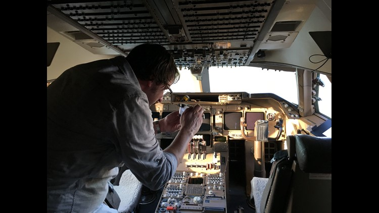 United frequent-flier Adam Johnson of Minneapolis takes pictures of the flight deck of the last Boeing 747 to fly paying passengers for United. Frequent fliers bid up to 420,000 miles for the experience of traveling to Mississippi to see the plane at an '