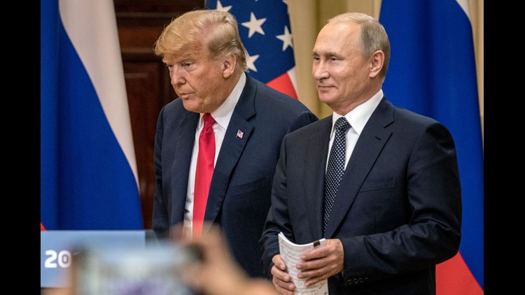 President Donald Trump and Russian President Vladimir Putin arrive to waiting media during a joint press conference after their summit on July 16, 2018, in Helsinki, Finland.
