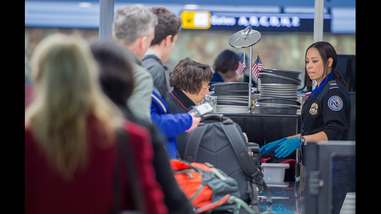 Christmas airline travelers are processed at a Transportation Safety Agency (TSA)  security checkpoint December 23, 2014 at Dulles International Airport (IAD) in Sterling, Virginia, outside Washington, DC, during the hectic holiday travel week.