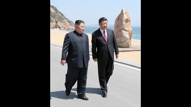 In this photo taken between May 7 and 8, 2018 released by Xinhua News Agency, Chinese President Xi Jinping, right, walks with North Korean leader Kim Jong Un during a meeting in Dalian in northeastern China's Liaoning Province. (Ju Peng/Xinhua via AP) ORG