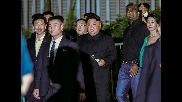 North Korea leader Kim Jong Un, center, is escorted by his security delegation as he visits Marina Bay in Singapore, June 11, 2018, ahead of Kim's summit with President Donald Trump.