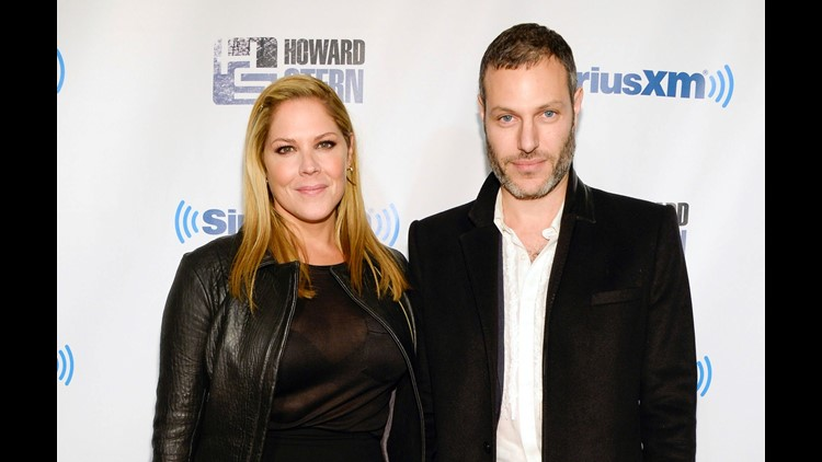 "Actress Mary McCormack, left, and husband Michael Morris attend ""Howard Stern's Birthday Bash,"" presented by SiriusXM, at the Hammerstein Ballroom in New York. McCormack has shared video of her husband's Tesla car shooting flames while in Southern Califor"