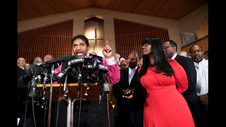 Rev. William Barber, president of the North Carolina chapter of NAACP, speaks at a news conference at Mayfield Memorial Missionary Baptist Church in Charlotte on Sept. 22, 2016, after a second night of violence following the fatal police shooting of Keith