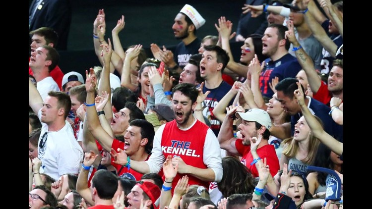 Gonzaga fans react during the first half of the national title game.