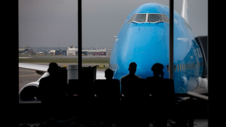 Passengers wait to board a KLM Boeing 747 at Amsterdam Schipol Airport on April 1, 2018.