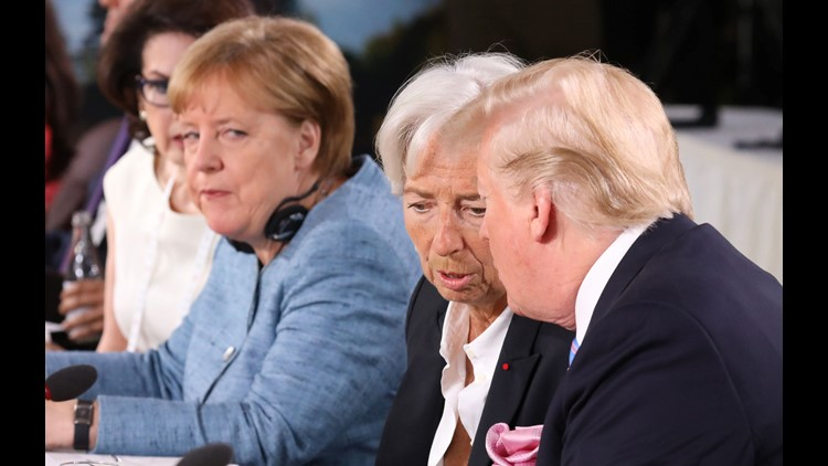 President Trump speaks with International Monetary Fund Managing Director Christine Lagarde as they attend the Gender Equality Advisory Council Breakfast during the G7 Summit in La Malbaie, Quebec, Canada, June 9, 2018.German Chancellor Angela Merkel is