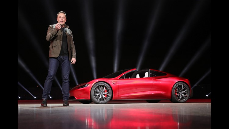 Tesla founder Elon Musk presenting the new Roadster electric sports vehicle (on background), presented to media on Nov. 16, 2017 at Tesla's Los Angeles design center. Tesla says the Roadster will accelerate from 0-60 mph in less than two seconds. Tesla sa