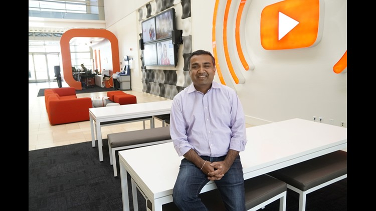 YouTube chief product officer Neal Mohan in the bright YouTube headquarters lobby in San Bruno, CA.