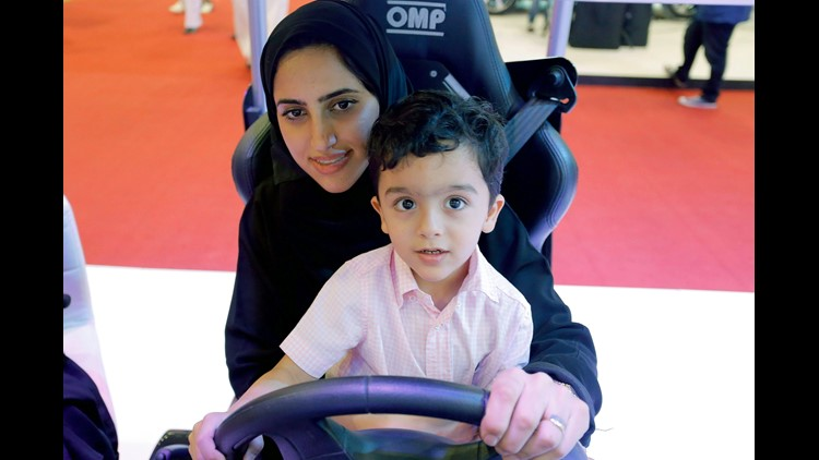 epa06734286 A women with a boy sits in a driving simulator during a car show only for women in Riyadh, Saudi Arabia, 13 May 2018. Women are expected to be allowed to drive cars in Saudi-Arabia starting in mid June 2018.  EPA-EFE/STR