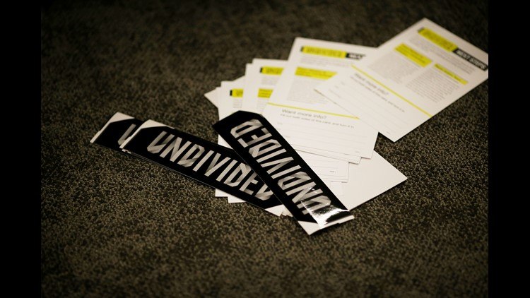A collection of stickers and literature during a meeting of the Undivided group at Crossroads Church in the University Heights neighborhood of Cincinnati on Wednesday, May 16, 2018.