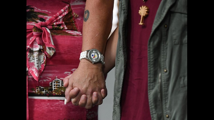 Fifteen-year-old Jordan Reyes, right, holds hands with her school bus driver Ilah Beard Friday, June 8, 2018 at the Anderson School District 5 administrative offices during a press conference to release the video showing where Reyes was narrowly missed by