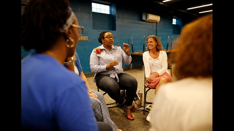 Charity Wright, of Lower Price Hill, talks about the results of a group discussion about implicit racial bias during a meeting of the Undivided group at Crossroads Church in the University Heights neighborhood of Cincinnati on Wednesday, May 16, 2018.