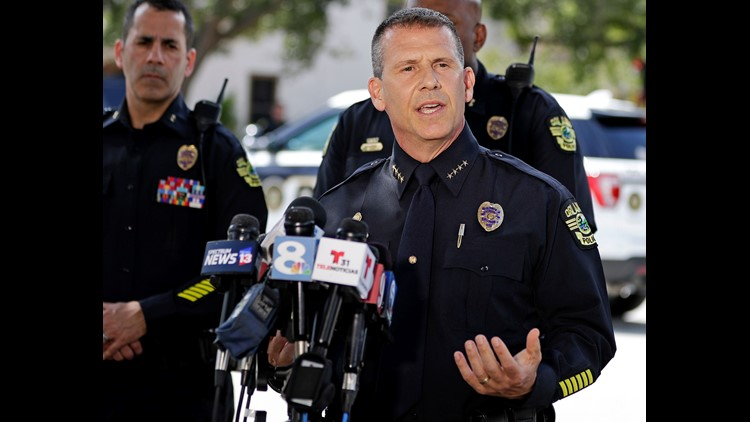 Orlando Police Chief John Mina answers questions at an afternoon news conference during a hostage standoff Monday, June 11, 2018, in Orlando, Fla. Police said a man suspected of battering his girlfriend shot a police officer late Sunday and barricaded him