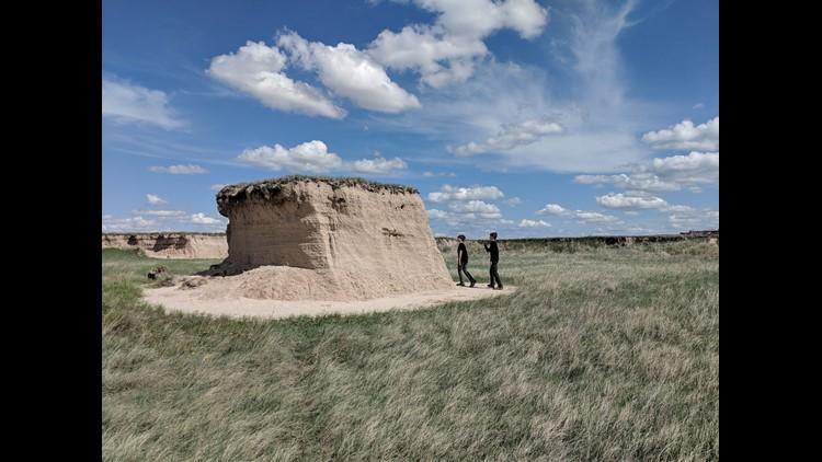 Iden and Aren Elliott check out a rock formation in South Dakota's Badlands National Park.
