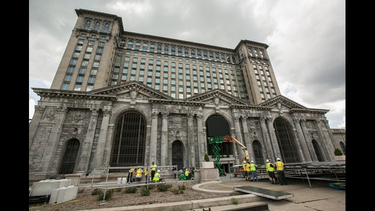 Workers set up for the upcoming train station party at Michigan Central Station in Detroit's Corktown neighborhood on Wednesday, June 13, 2018 to celebrate Ford Motor Company's purchase of the long-vacant building.