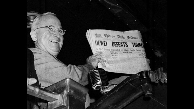 """FILE--President Harry S. Truman holds up a copy of an election day copy of the Chicago Tribune, which, based on early election night results, mistakenly announced """"Dewey Defeats Truman"""" for the benefit of the throng that turned out to greet him at St. Lou"""