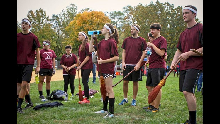 In this Oct. 19, 2013, photo, students from Lafayette College in Easton, Pa., attending a Quidditch match at an annual Harry Potter festival in Philadelphia.
