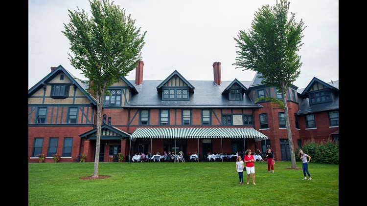 Diners enjoy the patio and grounds at The Inn at Shelburne Farms Aug. 22, 2017, in Shelburne, Vermont.