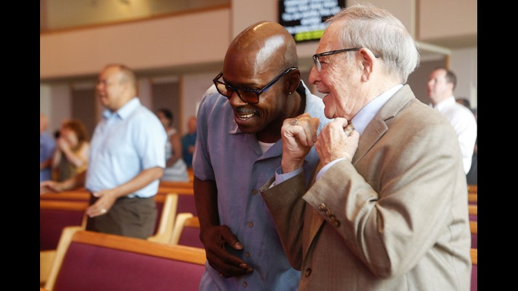 Marvis Ware, 59, greets pastor emeritus the Rev. Clyde Miller before the 9:30 Sunday morning service May 27 at the Peoples Church in Corryville.  Sunday, May 27, 2018, in Cincinnati.