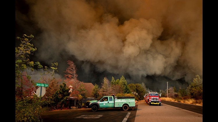 The Camp Fire rages through Paradise, Calif., on Thursday, Nov. 8, 2018. Tens of thousands of people fled a fast-moving wildfire Thursday in Northern California, some clutching babies and pets as they abandoned vehicles and struck out on foot ahead of the