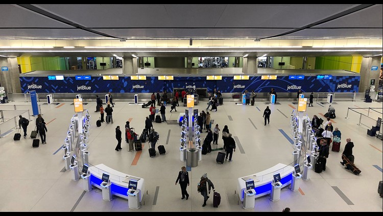 Passengers arrive at the JetBlue Airways' self-service lobby in Terminal C at Logan Airport in Boston on March 22, 2018.