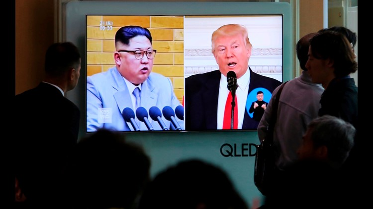 People watch a TV screen showing file footage of U.S. President Donald Trump, right, and North Korean leader Kim Jong Un during a news program at the Seoul Railway Station in Seoul, South Korea.