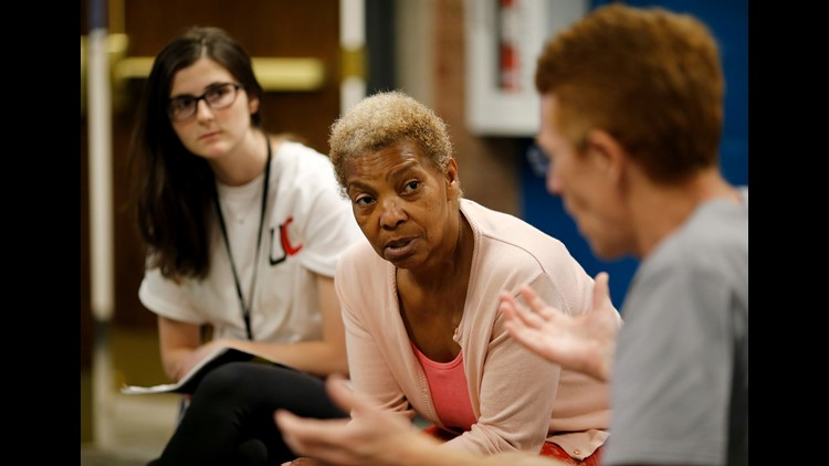 Wanda Davis, of Silverton, listens as Westin Worthington, Taylor Mill, talks about the results of a group discussion about implicit racial bias during a meeting of the Undivided group at Crossroads Church in the University Heights neighborhood of Cincinna