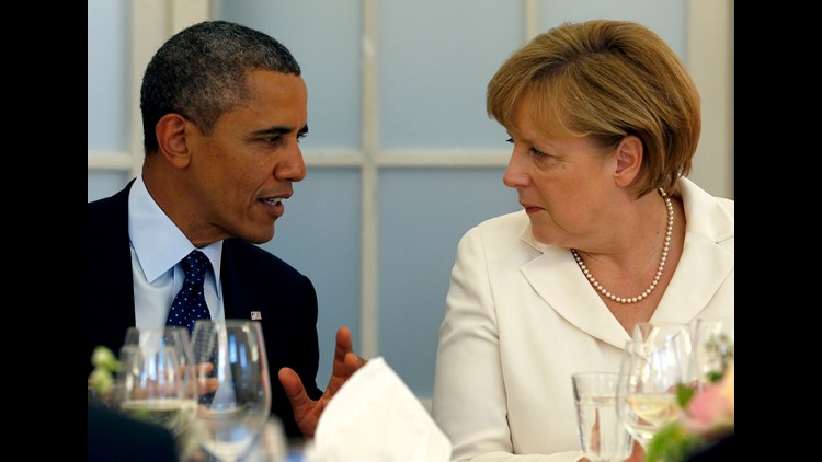 President Obama and German Chancellor Angela Merkel chat during a dinner at the Charlottenburg palace in Berlin Wednesday, June 19, 2013.