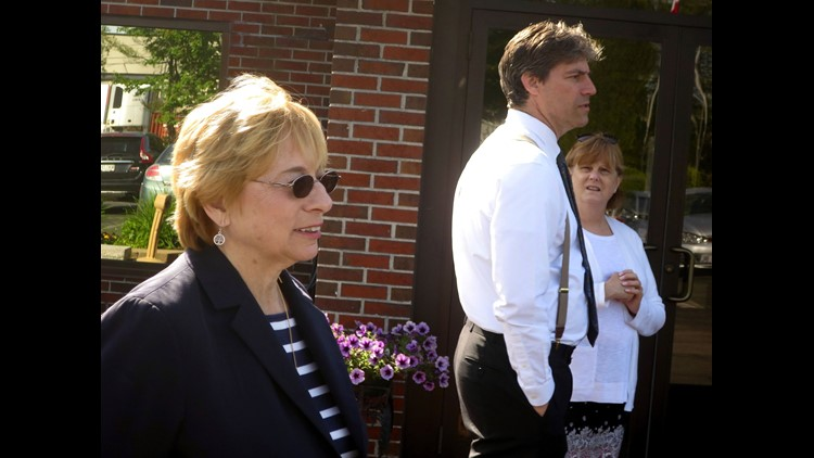 Maine Attorney General Janet Mills, left, who is one of seven Democrats facing off in a gubernatorial primary, greets voters outside a polling place, Tuesday, June 12, 2018, in Portland, Maine. The election is the first statewide primary to utilize ranked