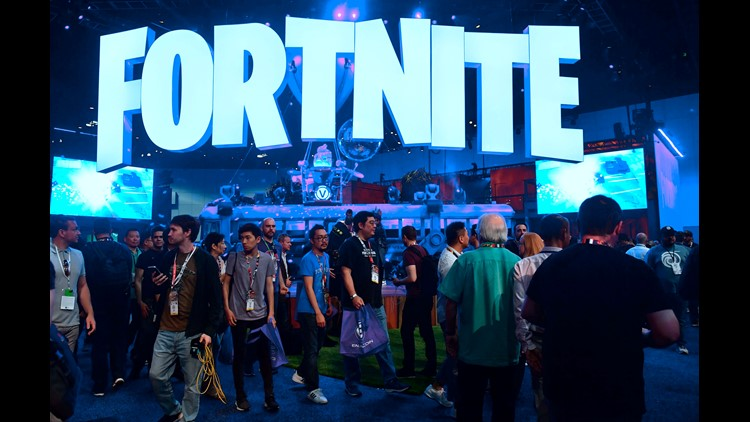 People crowd the display area for the survival game Fortnite.