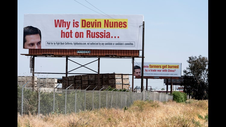 A pair of signs critical of Devin Nunes face southbound traffic on Highway 99 near Fowler.