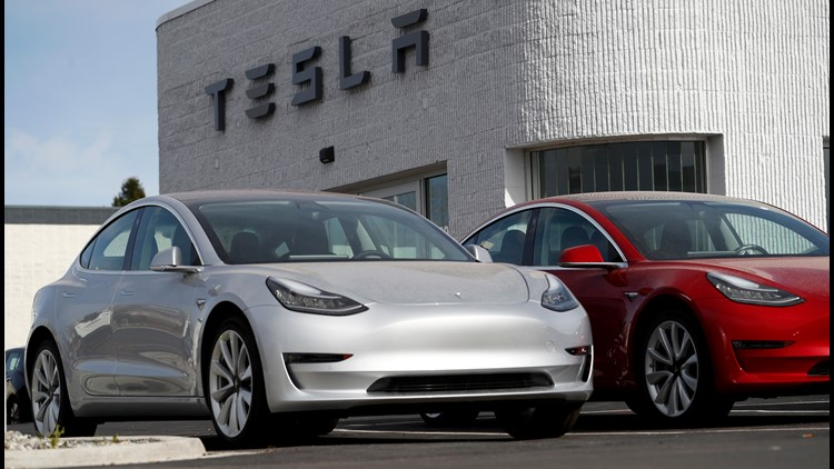 A Tesla Model 3 is seen on April 15, 2018 in  Littleton, Colo. It has a 220 mile range and starts at $35,000, according to Tesla.