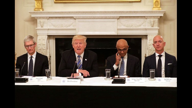 President Donald Trump meets with tech CEOs at the White House, including (L-R) Apple CEO Tim Cook, Microsoft CEO Satya Nadella and Amazon CEO Jeff Bezos.