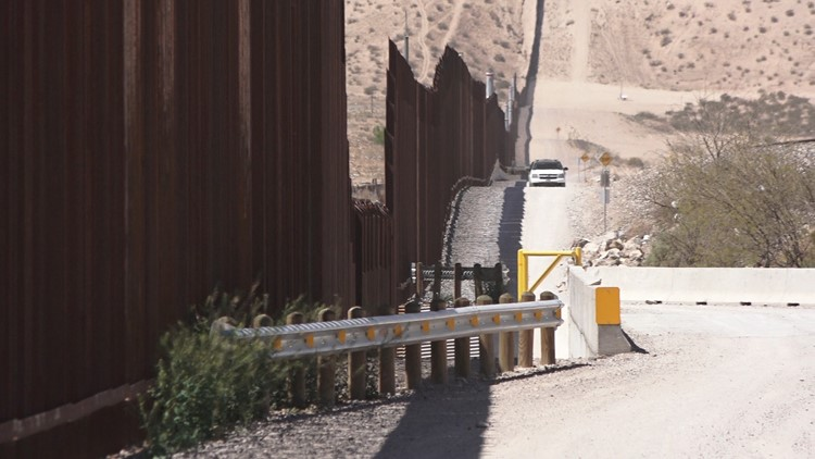 A US Border Patrol vehicle parks north of the border fence in Sunland Park, New Mexico