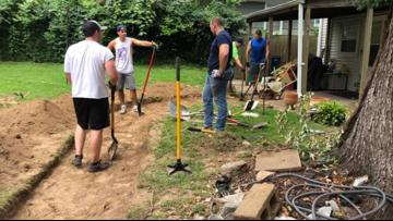 Firefighters use days off to build sidewalk for woman in wheelchair who had trouble getting into her home