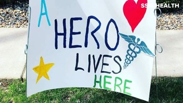'A hero lives here' | Paramedic creates yard signs to support coworkers during COVID-19