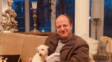 Colorado Governor tweets photo with pit bull after veto