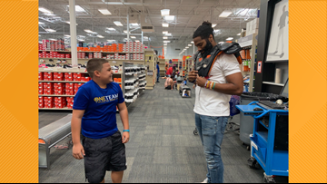 Retired Tennessee Titan Michael Griffin took 16 kids on a $200 'Back To Sport' shopping spree