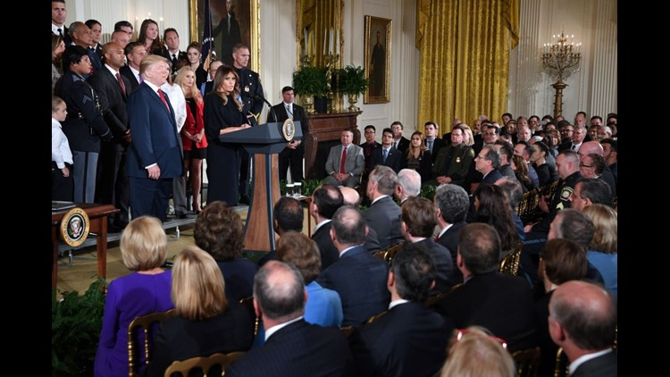 First Lady Melania Trump speaks before US President Donald Trump delivers remarks on combatting drug demand and the opioid crisis on October 26, 2017 in the East Room of the White House in washington, DC.