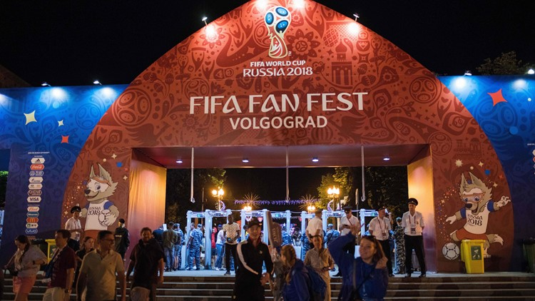 People arrive at the official FIFA Fan Fest in Volgograd on June 16, 2018 during the Russia 2018 World Cup football torunament. (NICOLAS ASFOURI/AFP/Getty Images)