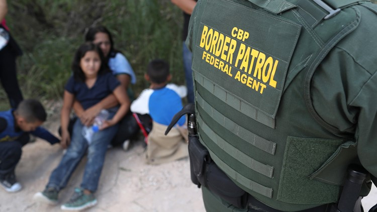 Central American asylum seekers wait as U.S. Border Patrol agents take them into custody on June 12, 2018 near McAllen, Texas. (Photo by John Moore/Getty Images)