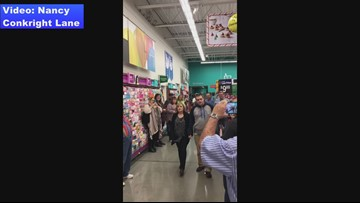 Watch: Sevierville couple walk down the aisle at the Walmart where their love bloomed