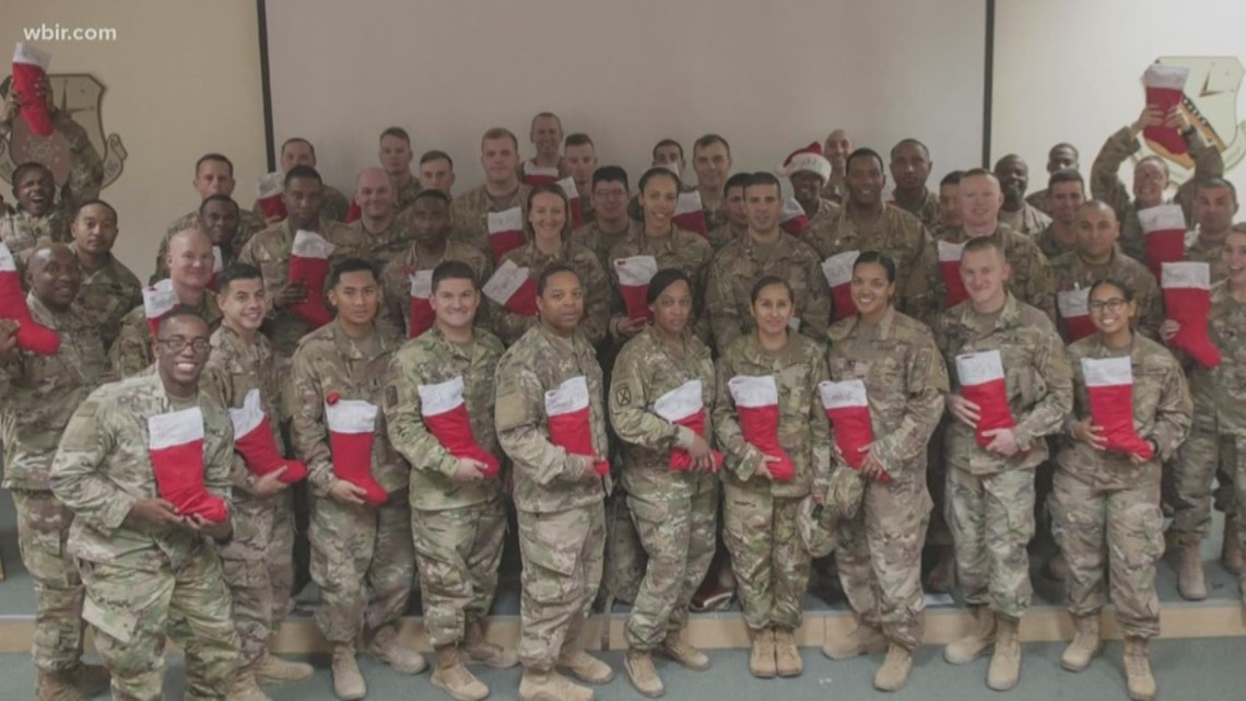 Military mom stuffs stockings for military members