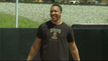 Grant Williams throws the first pitch at Tennessee Softball