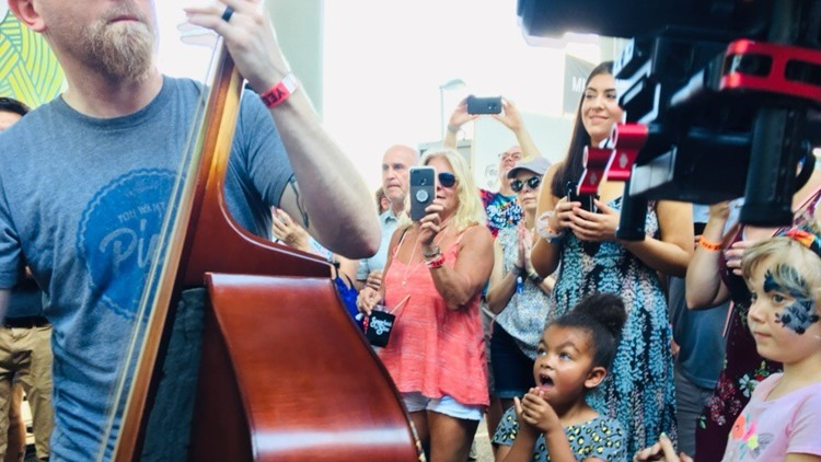 A child reacts to a bass player at this May's Rhythm N Blooms Festival.