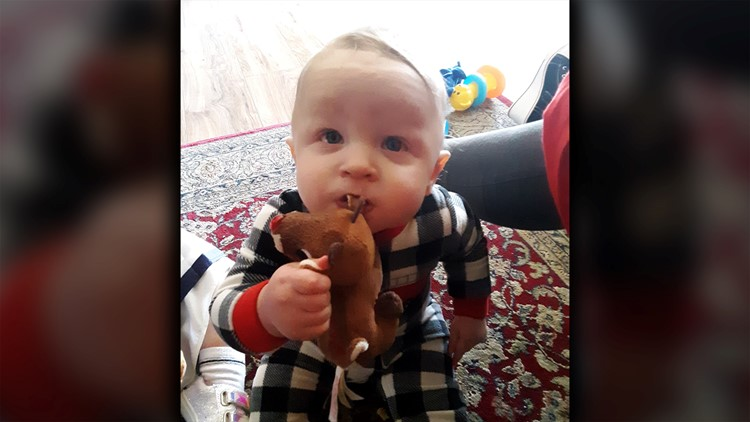 11-month-old Aiden Leonardo with Christmas Toy