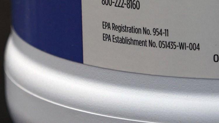 EPA registration number on disinfectant bottle at salon